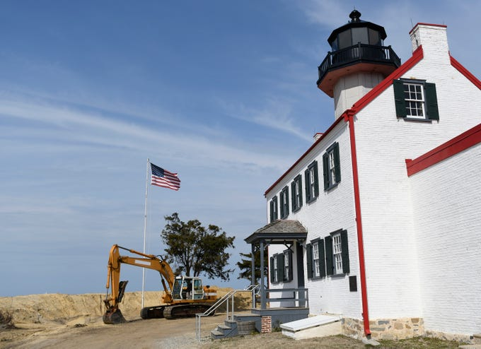 Efforts to rebuild the dune structure, that's helping save the East Point Lighthouse in Cumberland County from rising ocean levels, were underway on Friday, March 29, 2019.