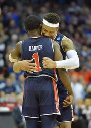 Auburn Tigers guards Bryce Brown and Jared Harper hug.