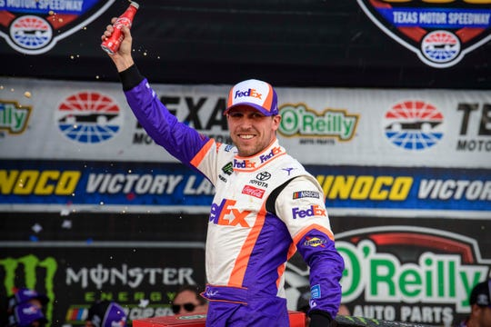 Denny Hamlin celebrates after winning the O'Reily Auto Parts 500 at Texas Motor Speedway.