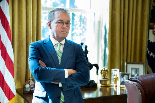 Acting White House Chief of Staff Mick Mulvaney stands by the Resolute desk in the Oval Office of the White House in Washington, March 27, 2019.