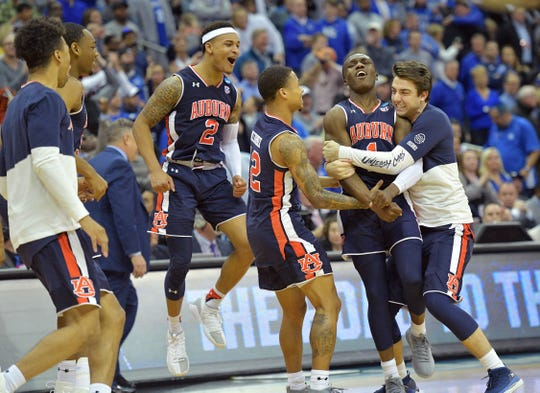 Auburn Tigers players including Jared Harper (1) , Bryce Brown (2) and J'Von McCormick (12) celebrate after defeating the Kentucky Wildcats.