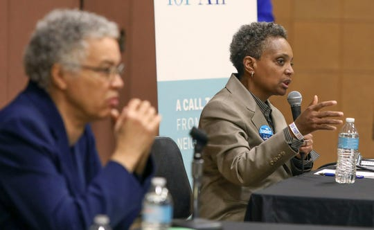 In this March 24, 2019 photo, Chicago mayoral candidate Lori Lightfoot, right, participates in a candidate forum sponsored by One Chicago For All Alliance at Daley College in Chicago. Lightfoot and Toni Preckwinkle, left, are competing to make history by becoming the city's first black, female mayor. On issues their positions are similar. But their resumes are not, and that may make all the difference when voters pick a new mayor on Tuesday.