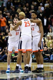 Virginia Cavaliers forward Mamadi Diakite (25) reacts with guard Ty Jerome (11) and guard De'Andre Hunter (12) during the second half of the game