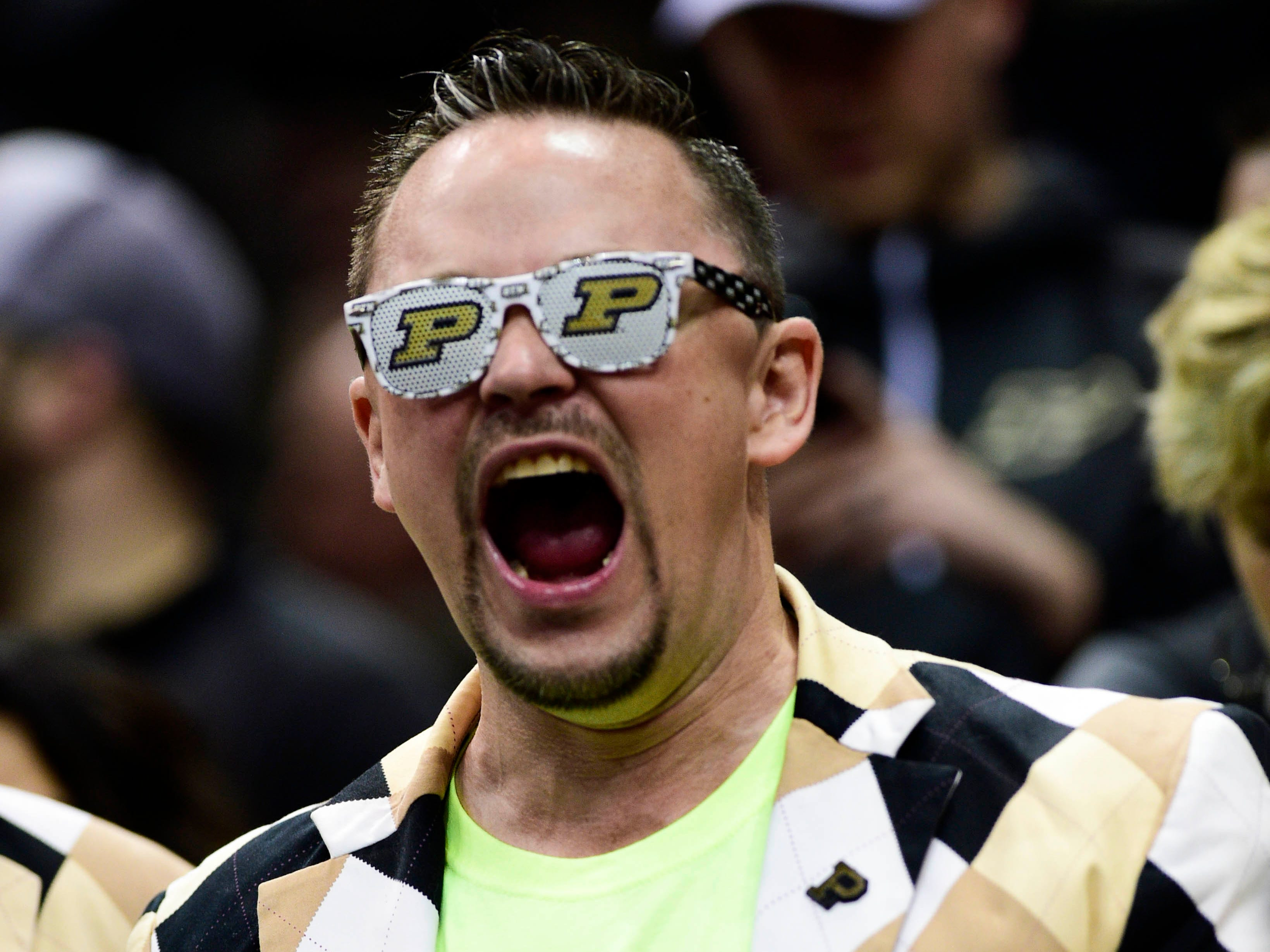 Elite Eight: A Purdue Boilermakers fan cheers before the game against the Virginia Cavaliers.