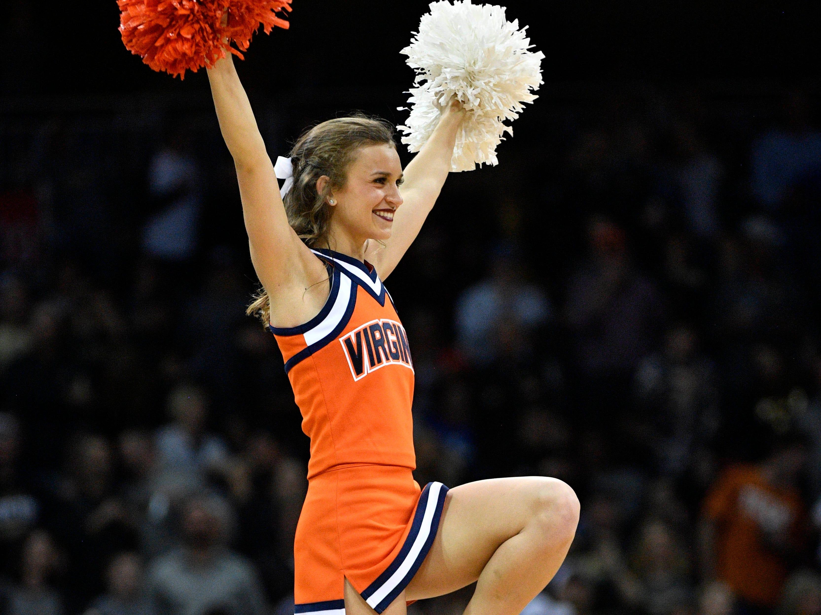 Elite Eight: Virginia Cavaliers cheerleaders perform during the second half against the Purdue Boilermakers.