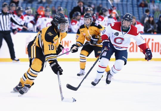 The National Women's Hockey League and the Canadian Women's Hockey League play an outdoor game in 2015. The CWHL says it is discontinuing operations.