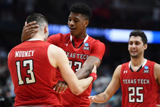 Texas Tech guards Matt Mooney (13, Davide Moretti (25) and Jarrett Culver (23) celebrate the victory against the Gonzaga Bulldogs.