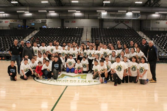 Justin Wetzel helped lead a Menominee Hoops clinic, which allowed Menominee National basketball players to practice basketball skills at the Menominee Nation Arena in Oshkosh.