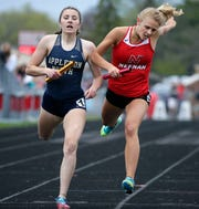 Sydney Squier, left of Appleton North and Krista Baumgartner of Neenah race to the finish of the 1,600-meter relay at the Fox Valley Association track and field conference championships in 2018.