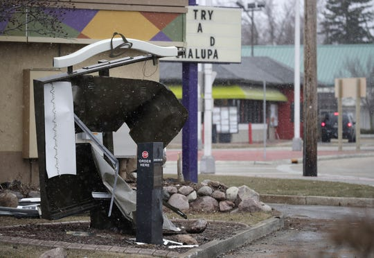 A destroyed Taco Bell drive-thru at the intersection of Northland Avenue and Richmond Street Monday, April 1, 2019, in Appleton, Wis.