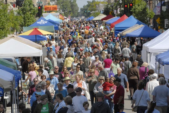 The farmers market in downtown Oshkosh attracts visitors of all generations.