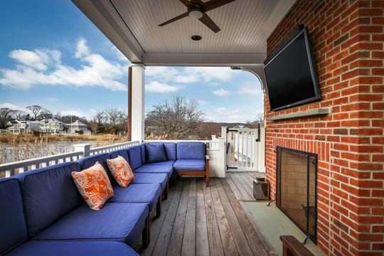 Outdoor oasis offers a fireplace and area for television.