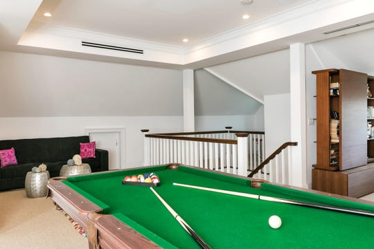 Entertain guest in a rec room that features recessed lighting and pool table.