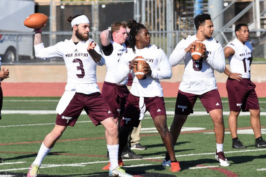 McMurry quarterbacks Kevin Hurley, Jr. (3), Xavier Alexander (2) and Matt Heifner (8) get set to throw during the first spring practice at Wilford Moore Stadium on Monday.