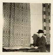 Frances Goodrich with a woven coverlet, the Double Bow Knot.