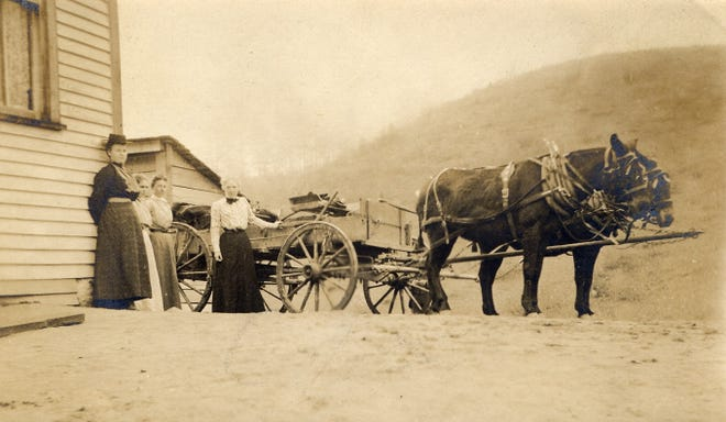 Frances Goodrich, one of the originators of the Southern Highland Craft Guild, preparing the wagon to take goods from Allanstand Cottage Industries to market.