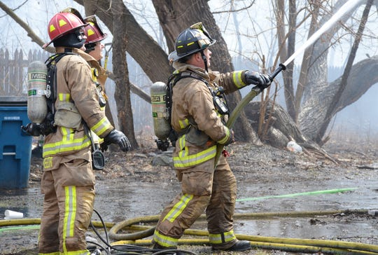 Firefighters battle a blaze Sunday at 513 Hamblin Ave.