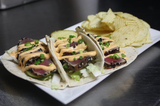 Seared Tuna Tacos, served with napa cabbage, avocado, pickled cucumber and siracha aioli, were featured as a special on the menu on The Pour House Pub and Grill in Johnson City on March 29.