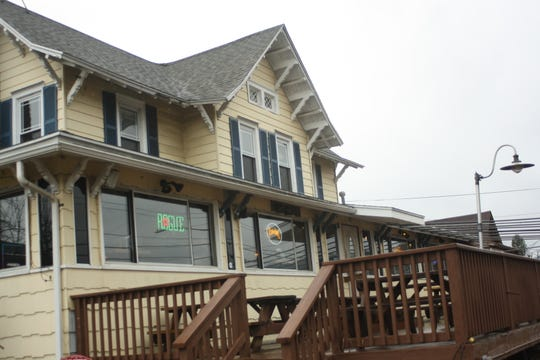 The Pour House Pub and Grill features a deck with outdoor seating.