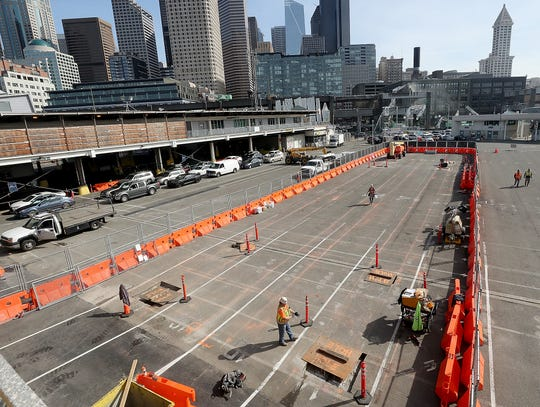 An elevated passenger walkway will connect the main ferry terminal building to a new entrance building along Alaskan Way.
