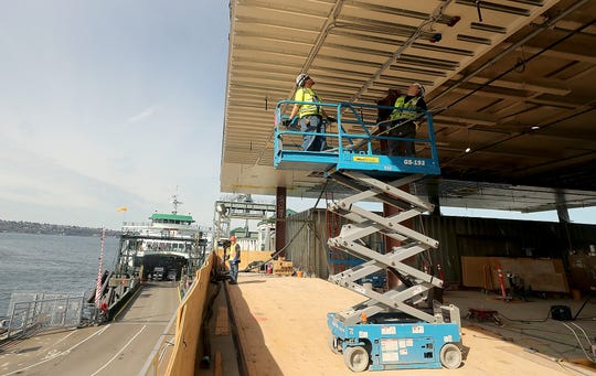 A lift is moved into position as crews work on the new terminal building at Colman Dock in Seattle.
