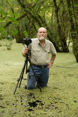 Cocoa Beach native Roger Hammer photographing ghost orchids at Fakahatchee Strand Preserve State Park.