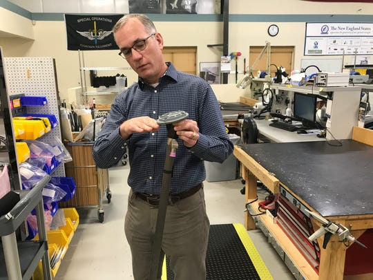 Mark Connors, Liquid Measurement System's chief technology, explains in April 2019 how the company's carbon fiber probe fits into an aircraft's fuel tanks.