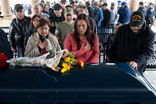 People pay their respects to United States Air Force SGT Andrew Cavazos Ybarra during his military burial at the Coastal Bend State Veterans Cemetery on Monday, April 1, 2019.