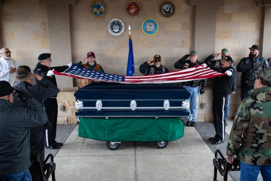 The flag over the casket of United States Air Force SGT Andrew Cavazos Ybarra is folded during his military burial at the Coastal Bend State Veterans Cemetery on Monday, April 1, 2019.