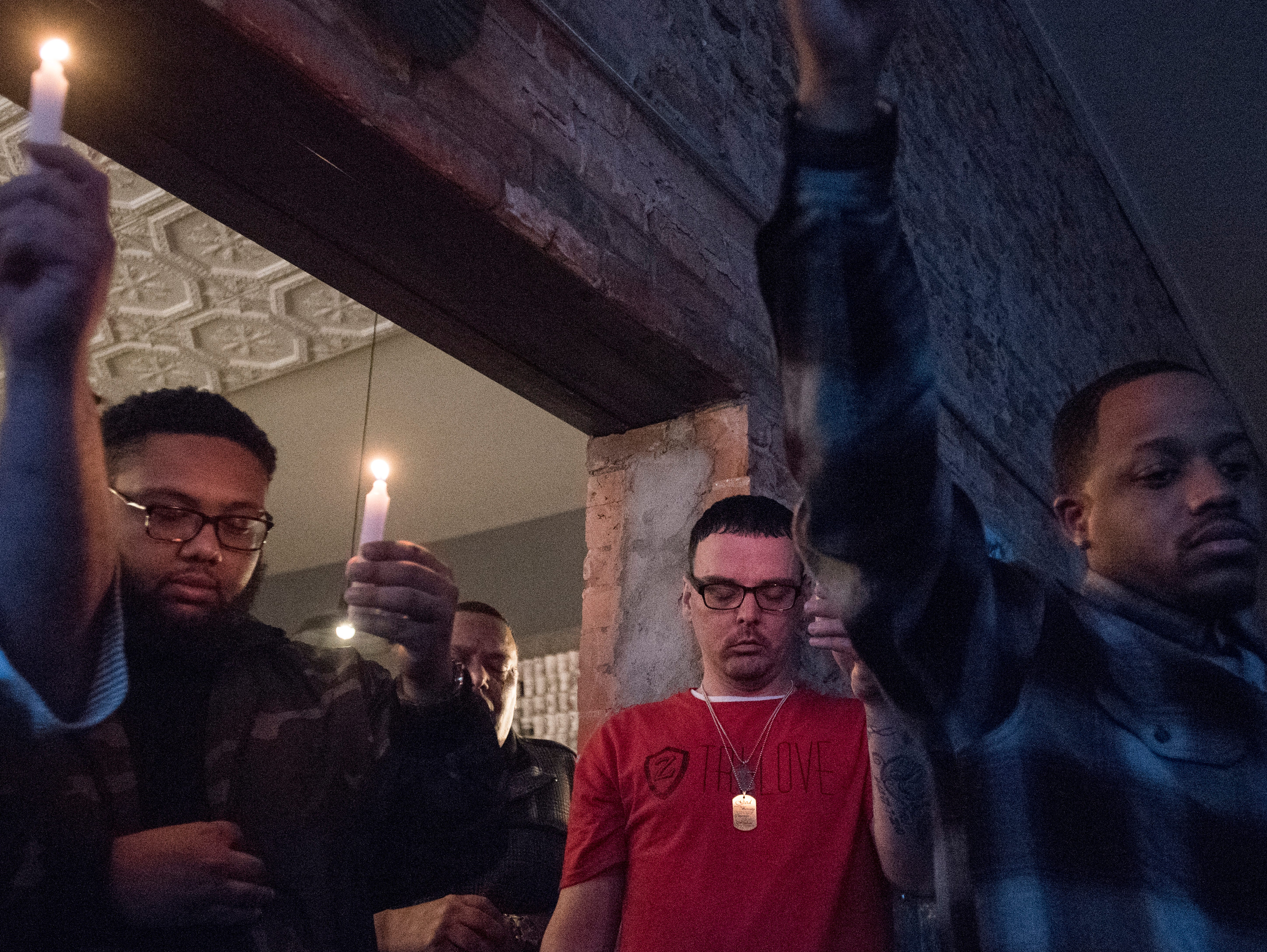 Another Chance Ministry's Night of Hope attendees hold a candlelight vigil Sunday at Paper City Coffee for those struggling with drug addiction.