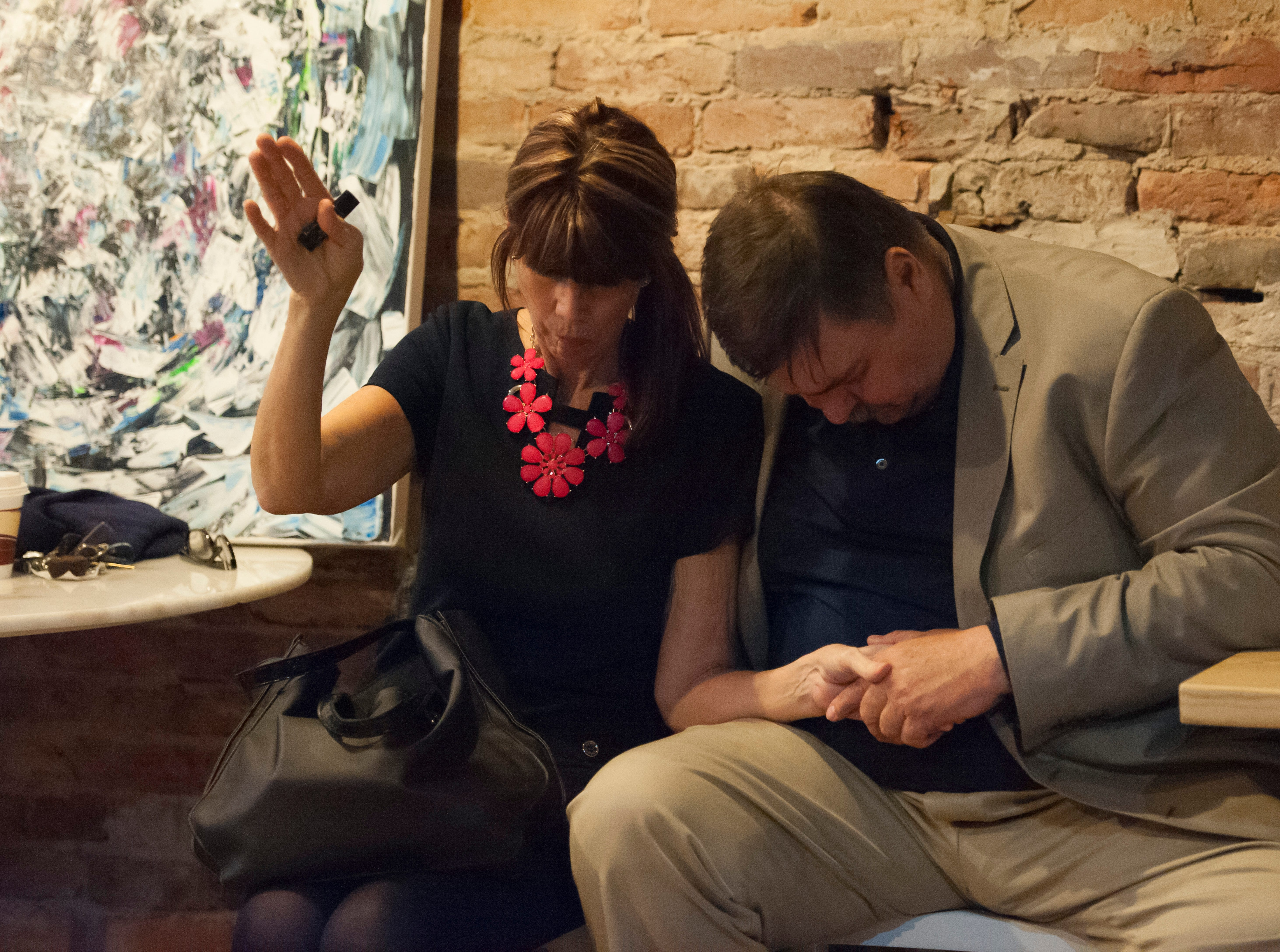John and Debra Ward pray together at the end of Zion Baptist's Night of Hope event Sunday night at Paper City Coffee. Their son Timothy Stacey talked to a group of 50 people about his drug addiction issues and how his parents were a major part of his recovery.
