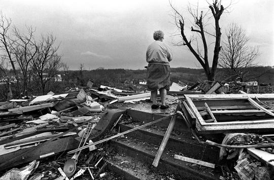 Mary Feldkamp stands on what was left of her home in Dent, Ohio, after the Super Outbreak of tornadoes struck the region on April 3, 1974.
