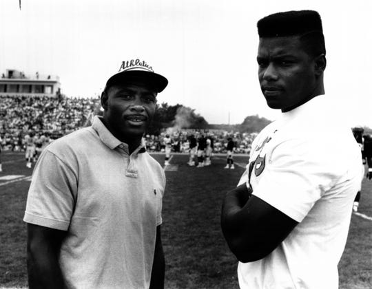 AUGUST 4, 1990: Running back James Brooks, left, and linebacker Joe Kelly watched Saturday's, 8/4/90, scrimmage from the sidelines. Brooks, signed Saturday, will be in uniform Monday, 8/6/90. Kelly remains unsigned. The Enquirer/Tony Jones