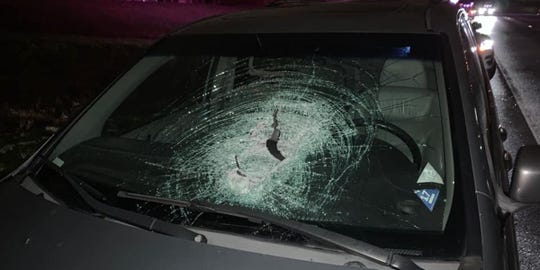 The Boone County Sheriff's department is searching for the person who threw a large rock into the windshield of a car and left a man with serious injuries.