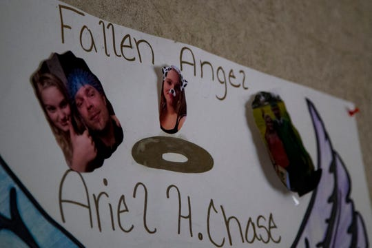 A poster hangs in Michael Chase's home in Montgomery County on March 14, 2019. His daughter Ariel died by suicide on March 4, 2019.