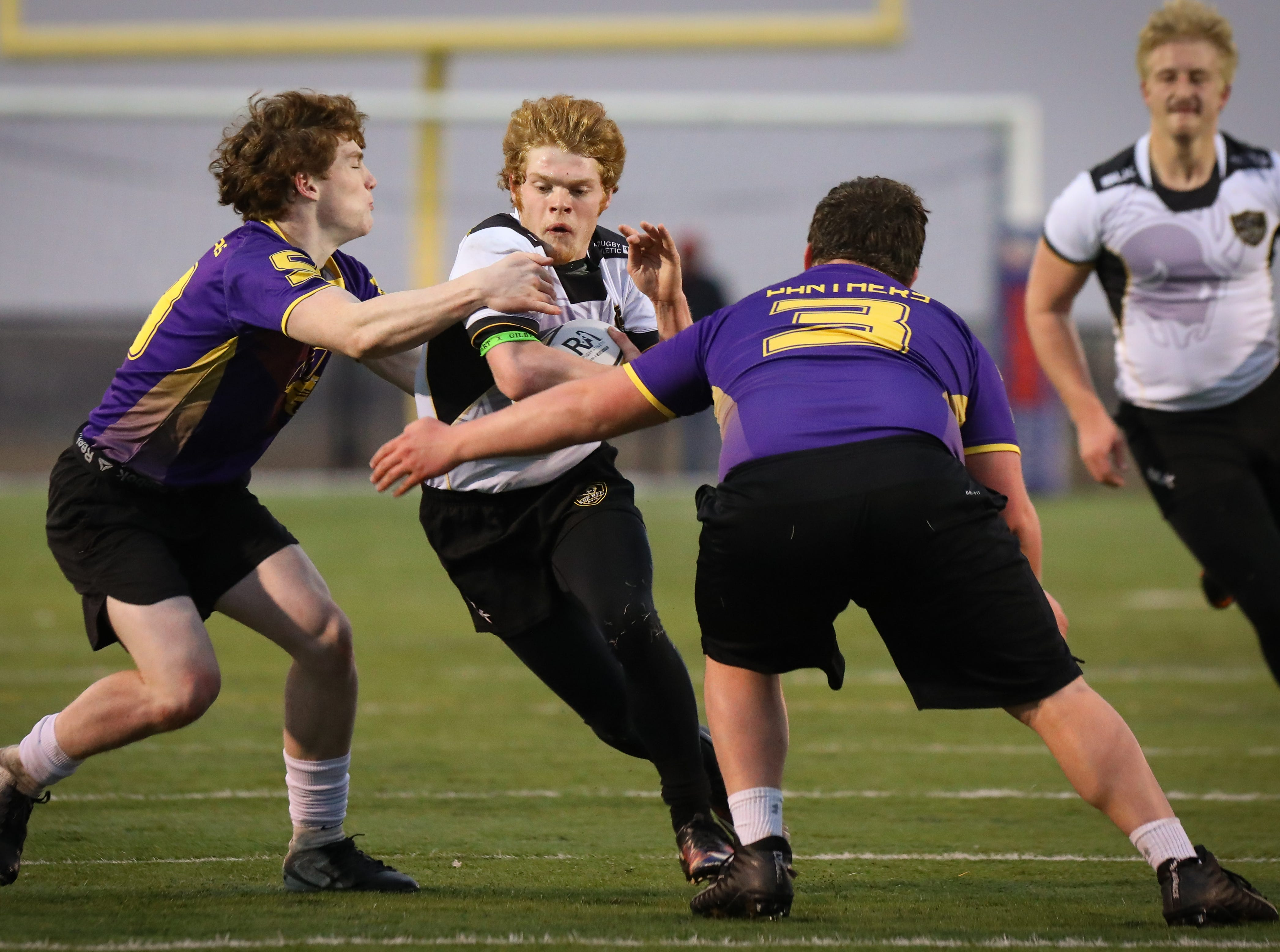 Southeast Polk (white shirts) and Fort Dodge (purple shirts) face off at a high school rugby match Friday, March. 29, 2019 at Spring Creek Sports Complex in Altoona, Iowa. Southeast Polk won their 100th game.
