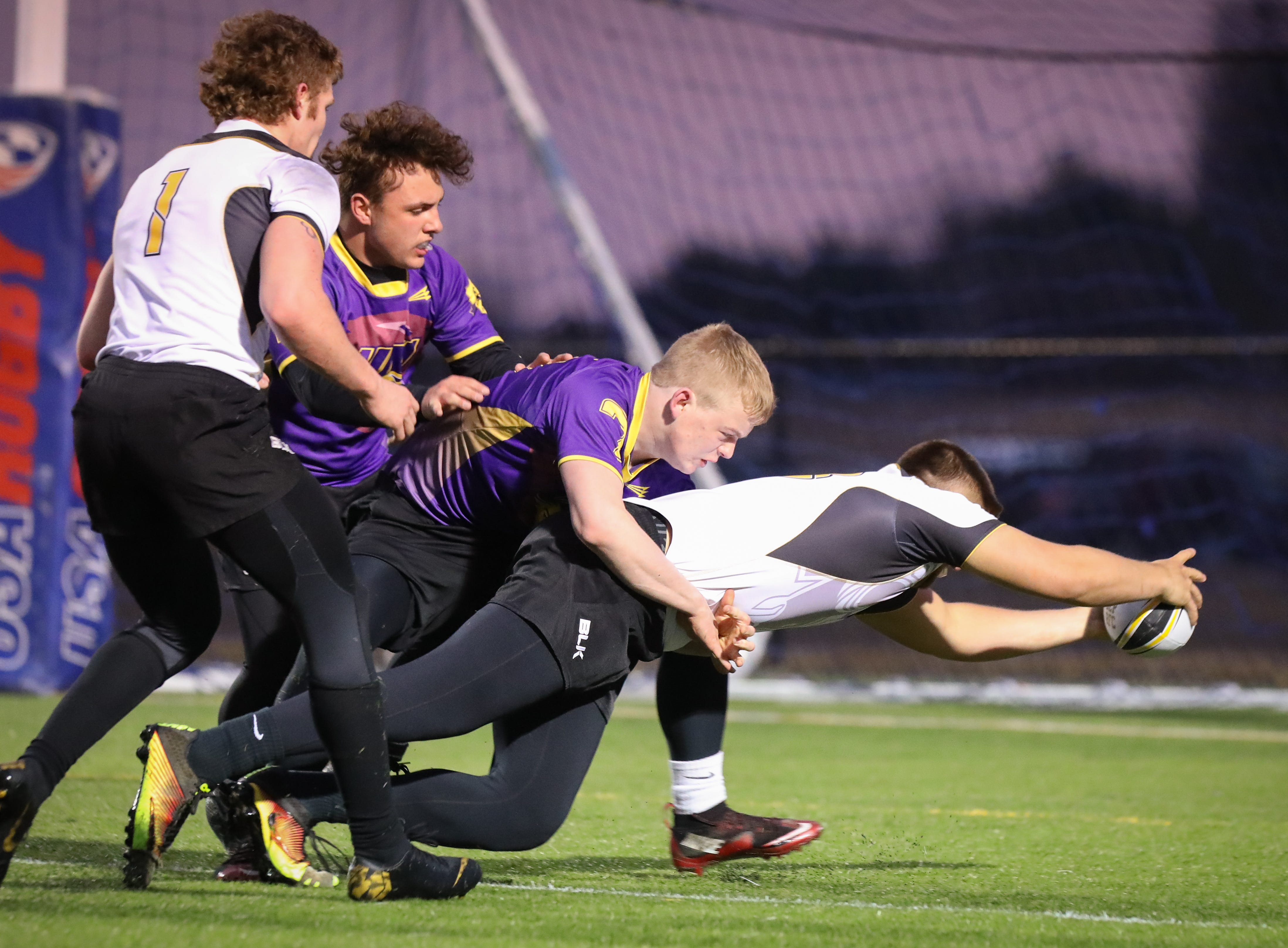 Southeast Polk (white shirts) and Fort Dodge (purple shirts) face off at a high school rugby match Friday, March 29, 2019 at Spring Creek Sports Complex in Altoona, Iowa. Southeast Polk won their 100th game.