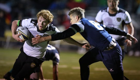 Southeast Polk (white shirts) and Roosevelt (blue shirts) face off at a high school rugby match Friday, March 29, 2019 at Spring Creek Sports Complex in Altoona, Iowa.