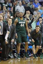 MSU players react after a basket against Duke during second half of MSU's 68-67 win in the NCAA tournament East Region final on Sunday, March 31, 2019, in Washington.
