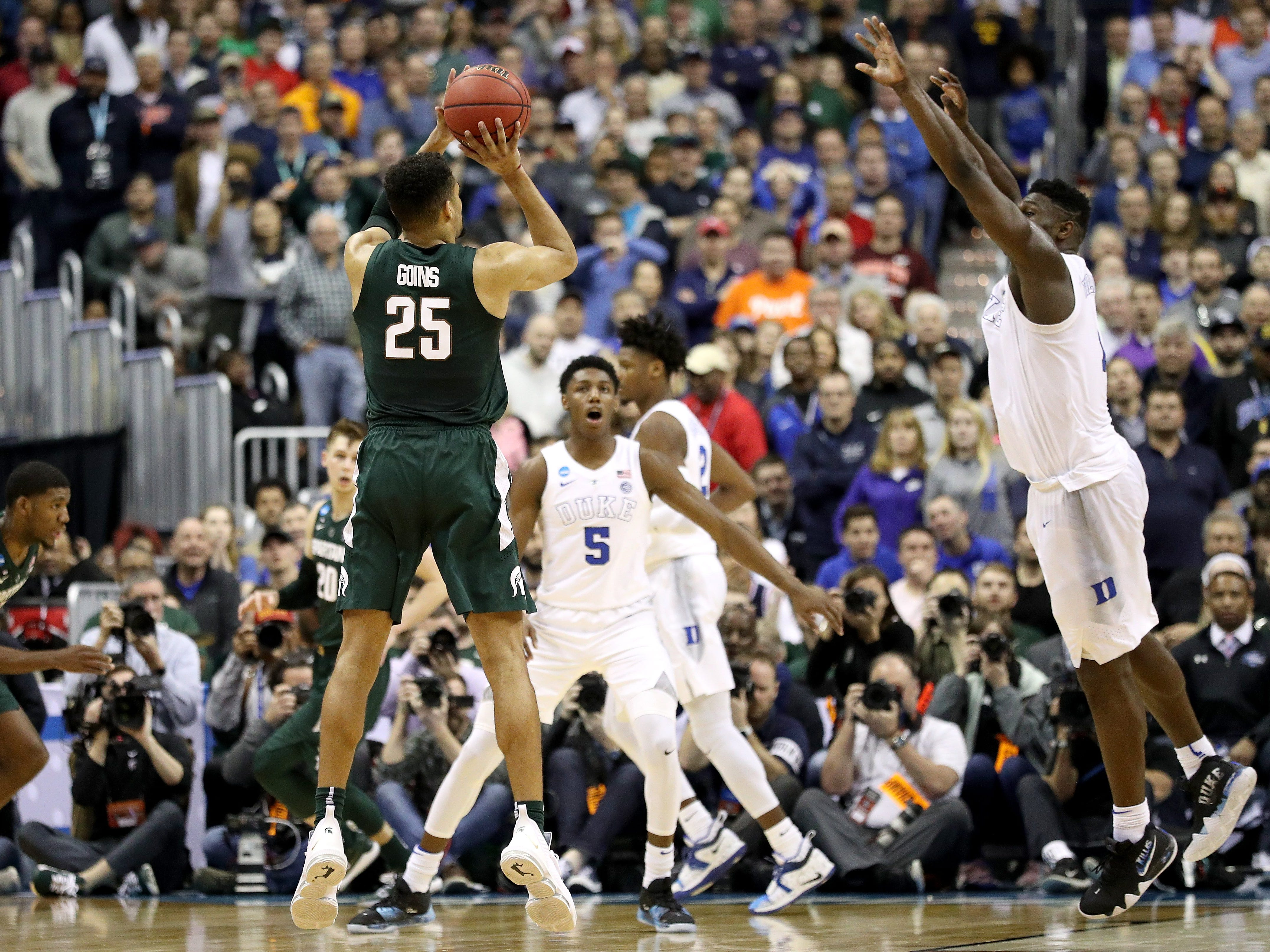 Michigan State's Kenny Goins hits the go-ahead 3-pointer late in the game over Duke's Zion Williamson in the East Regional of the NCAA tournament at Capital One Arena on March 31, 2019 in Washington, D.C.