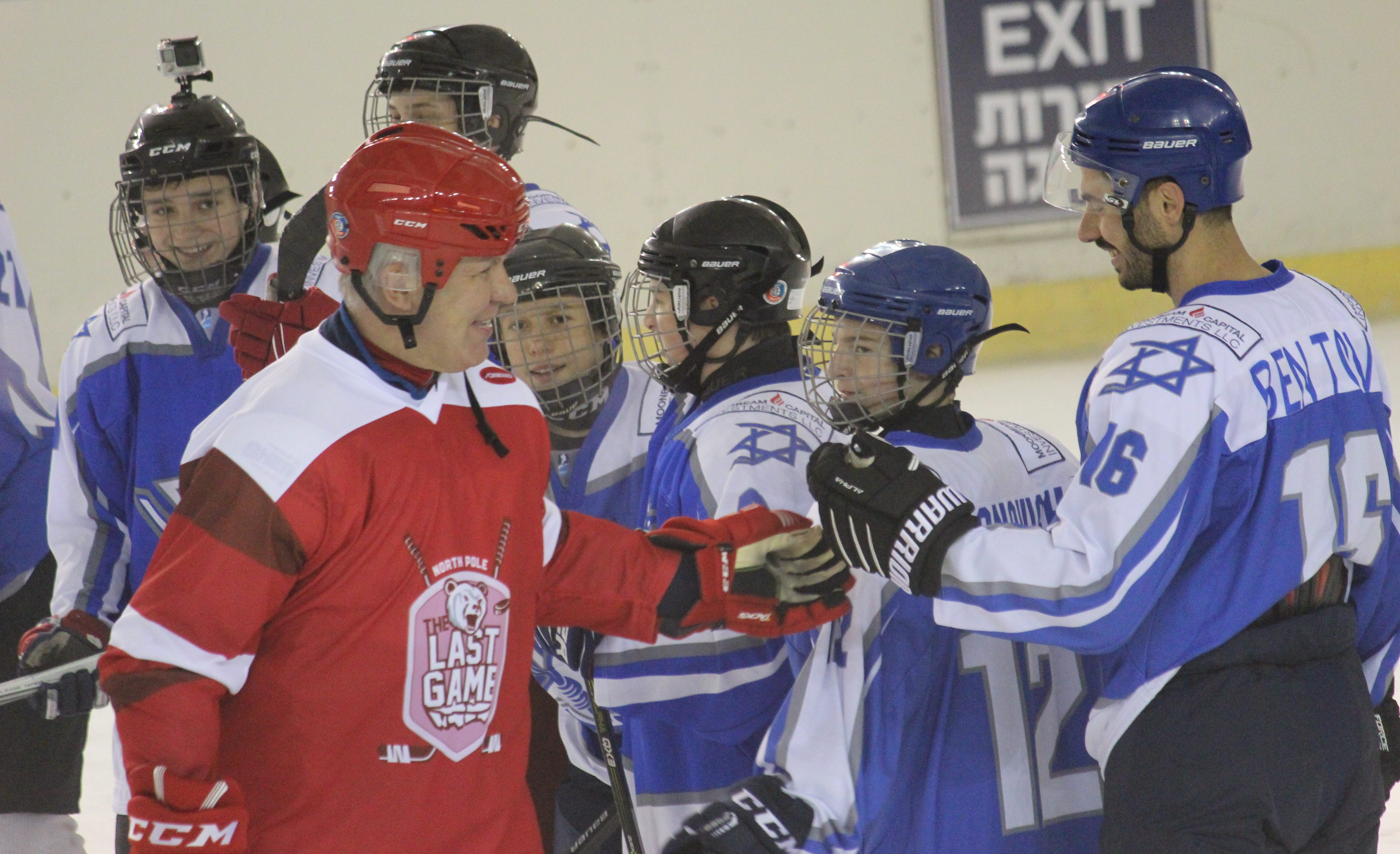 Former Red Wings defenseman Slava Fetisov shakes hands with players in Israel on Sunday, March 31, 2019,