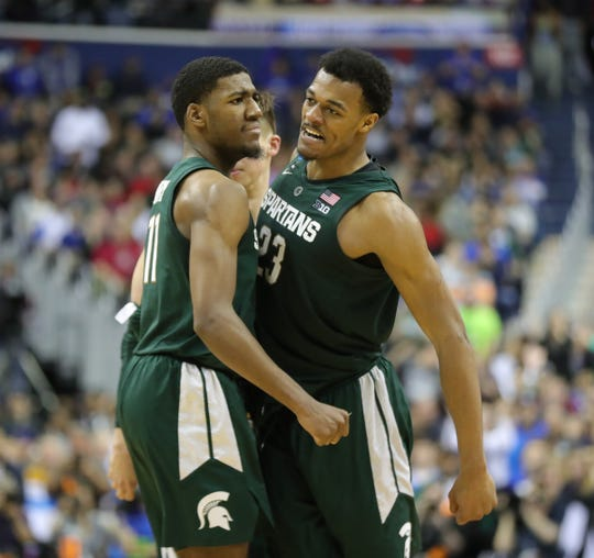 MSU forward Xavier Tillman celebrates with Aaron Henry  after his dunk on Duke forward Javin DeLaurier during second half action of the  NCAA Regional Final Sunday, March 31, 2019 at  Capital One Arena in Washington, DC.
