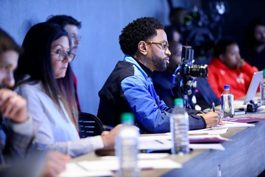 """Ally chief marketing officer Andrea Brimmer and Sean """"Big Sean"""" Anderson watch the pitches of Moguls in the Making student participants on Sunday, March 31, 2019 in Detroit."""