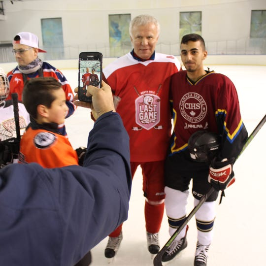 Former Red Wings defenseman Slava Fetisov shakes hands with fans and players in Israel on Sunday, March 31, 2019,