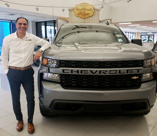 Ali Reda, one of America's top car salesman, says the Chevy Equinox is a better seller than Chevy Silverado, which is having a tough time against Ford F-150 and Ram 1500. He is pictured in March 2019 at the Les Stanford Chevrolet Dealership in Dearborn.