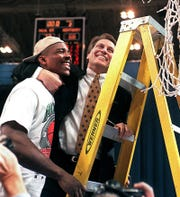 Tom Izzo hugs forward Antonio Smith, after MSU's victory over Kentucky in 1999 to get to the Final Four.