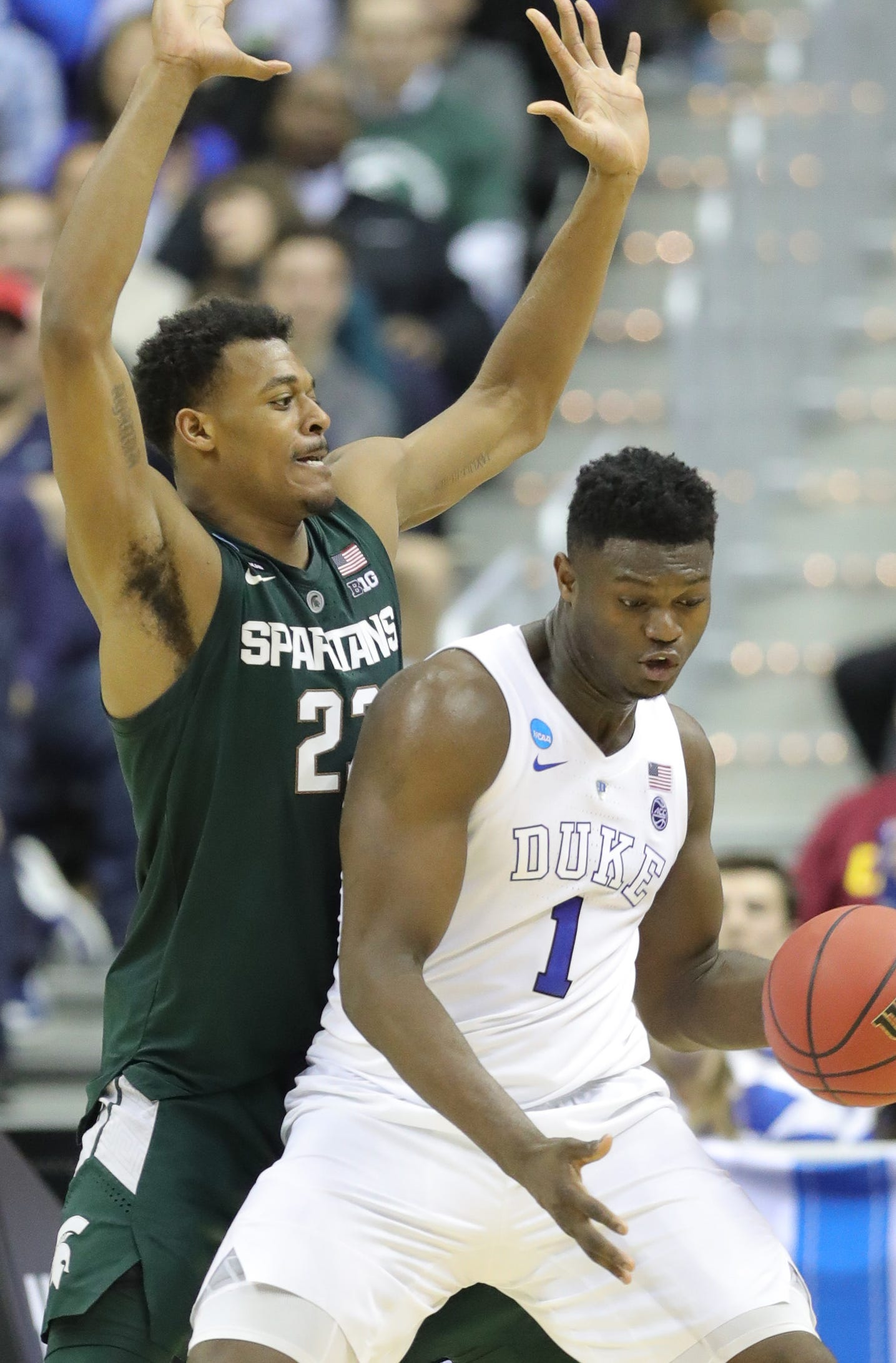 MSU forward Xavier Tillman defends against Duke forward Zion Williamson during the second half of MSU's 68-67 win in the NCAA tournament East Region final on Sunday, March 31, 2019, in Washington.
