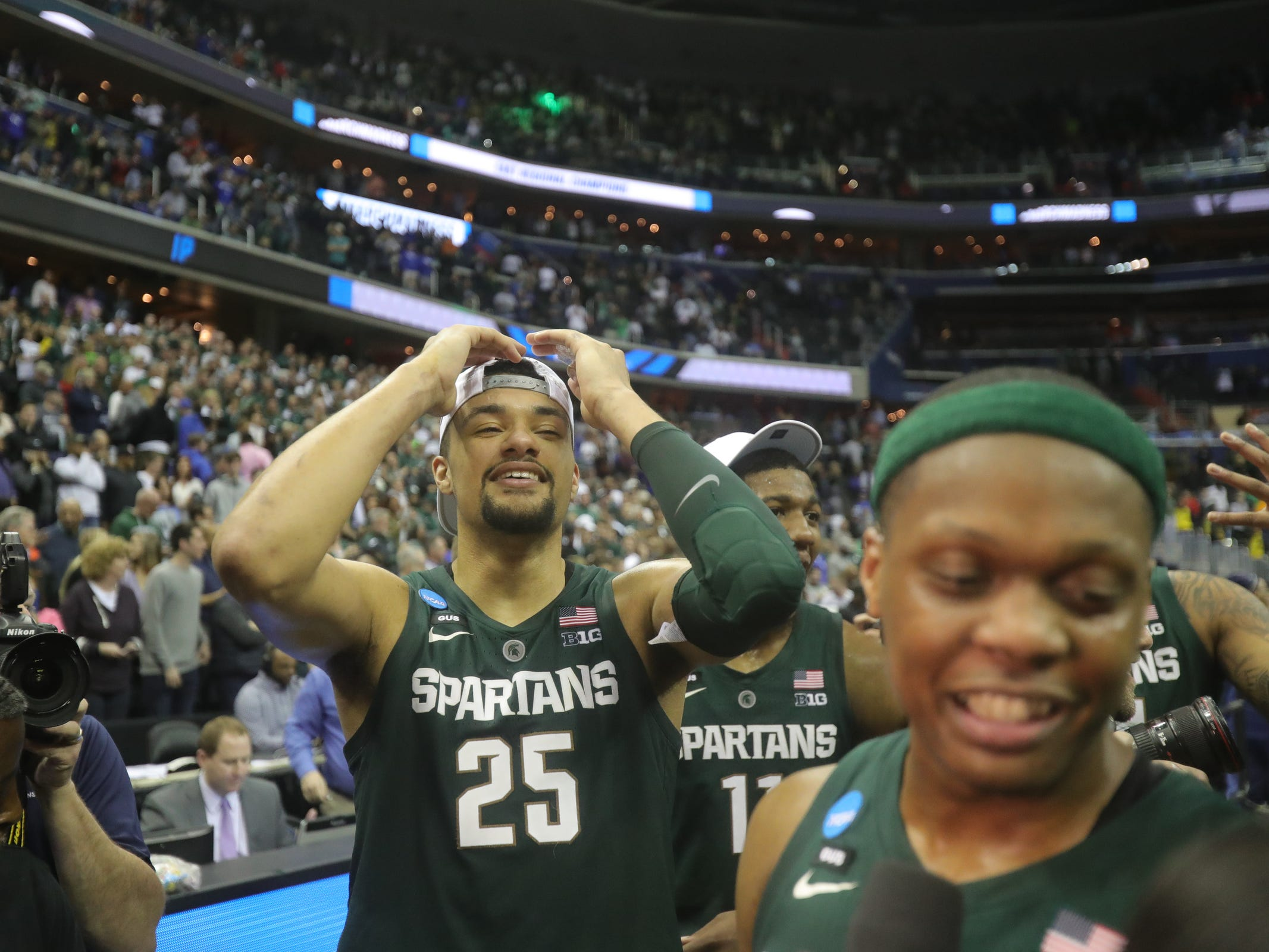 Michigan State's Kenny Goins puts on his Final Four hat after Michigan State celebrates after MSU's 68-67 win in the NCAA tournament East Region final on Sunday, March 31, 2019, in Washington.