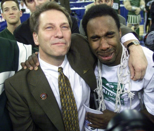 Teary-eyed Spartan coach Tom Izzo stands with an equally teary Mateen Cleaves, as they listen and watch the overhead screen playing the team tribute Monday, April 3, after the NCAA Championship game against the University of Florida at the RCA Dome in Indianapolis.