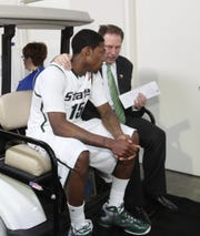 Michigan State head coach Tom Izzo talks with Durrell Summers as they ride a golf cart from the locker room to the post game media session after their 52-50 loss to Butler in the NCAA  Final Four semi finals in Indianapolis, IN on Saturday, April 03, 2010.